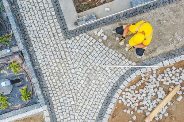worker-paving-garden-path-aerial-vista-hznjzn2_optimized